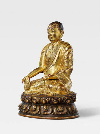 A GILT COPPER ALLOY FIGURE OF THE SIXTH ABBOT OF NGOR MONASTERY, GORAMPA SONAM SENGGE TIBET, 15TH/16TH CENTURY