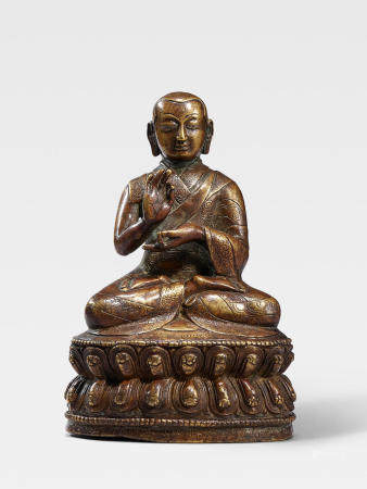 A SILVER INLAID BRASS ALLOY FIGURE OF THE SEVENTH ABBOT OF NGOR MONASTERY, KONCHOK PEL TIBET, 16TH CENTURY
