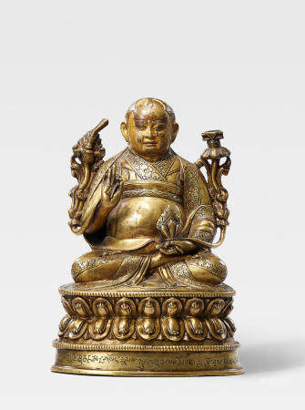 A BRASS FIGURE OF LOWO KHENCHEN SONAM LHUNDRUP, ABBOT OF THE KINGDOM OF LO TIBET, 16TH CENTURY