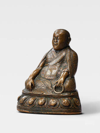 A SILVER AND COPPER INLAID BRASS FIGURE OF THE FOUNDER OF THE JONANG ORDER, DOLPOPA SHERAB GYALTSEN TIBET, 16TH CENTURY