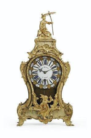 A LOUIS XV ORMOLU-MOUNTED GREEN-STAINED HORN CARTEL CLOCK