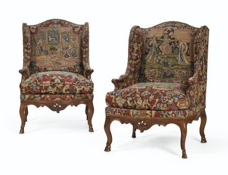 A PAIR OF EARLY LOUIS XV WALNUT BERGERES A OREILLES