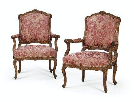 A PAIR OF NORTH ITALIAN WALNUT ARMCHAIRS