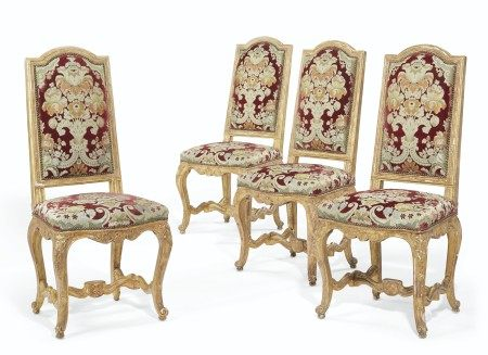 A SET OF TEN REGENCE-STYLE GILT-WALNUT DINING CHAIRS
