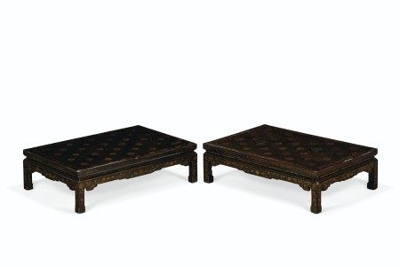 A NEAR PAIR OF CHINESE BLACK AND GILT-LACQUER KANG LOW TABLES