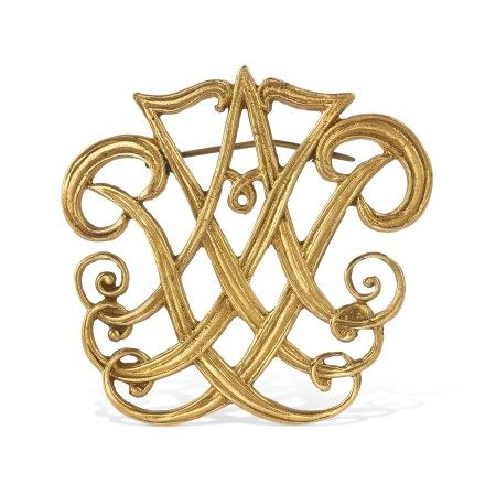 A GILT-METAL CYPHER PIN