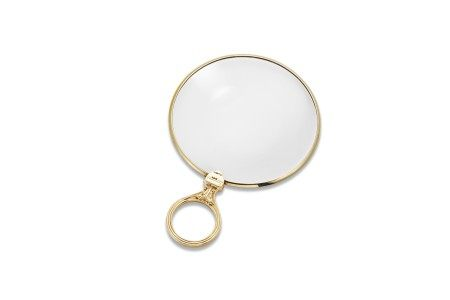 A GOLD MAGNIFYING GLASS