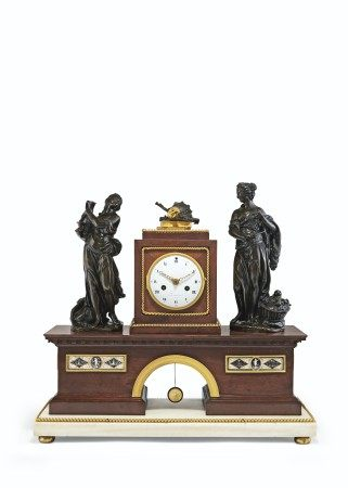 A DIRECTOIRE ORMOLU-MOUNTED MAHOGANY, PATINATED-BRONZE AND PORCELAIN MANTEL CLOCK