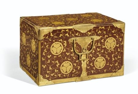A JAPANESE GILT AND BROWN LACQUER BOX AND COVER