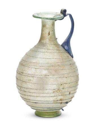 A small Roman light green glass jug