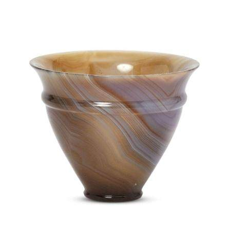 A carved agate cup with flared rim