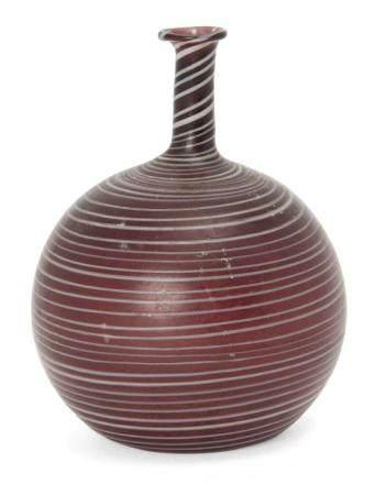 A Phoenecian trailed aubergine glass flask