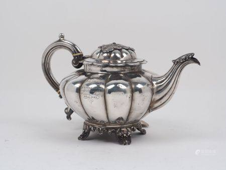A Victorian silver melon-shaped teapot, London, c.1843, maker's mark rubbed, the lobed body raised