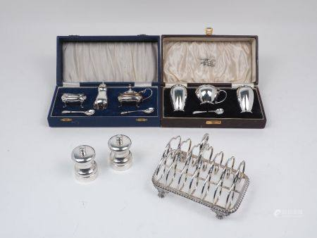 A George IV silver toast rack, London, c.1819, Rebecca Emes & Edward Barnard, together with two