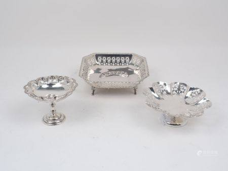 Three pierced silver dishes, comprising a squared bonbon dish raised on four scroll feet, Sheffield,