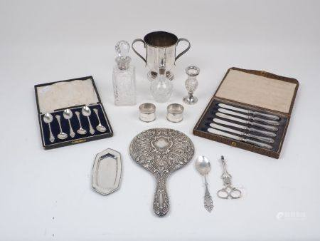 A pair of Georgian silver sugar nips with shell design bowls, together with a cased set of six