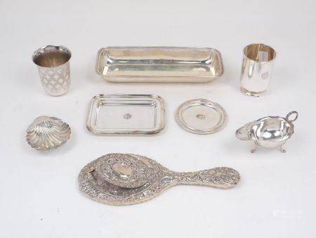 A group of silver items comprising: a Continental silver tumbler decorated with quatrefoil motifs