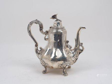 A nineteenth century French silver coffee pot by Martial Fray, Paris, c.1850, the lobed body