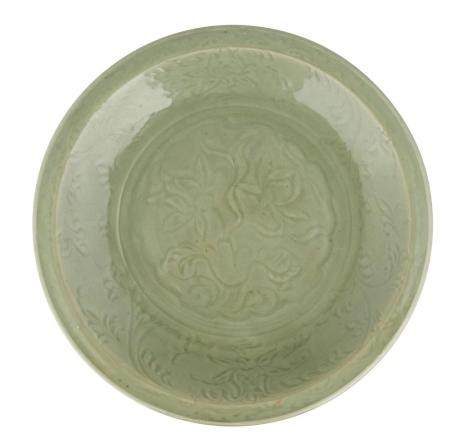 A LARGE CARVED CELADON LONGQUAN DISH, CHINA, MING DYNASTY, 1
