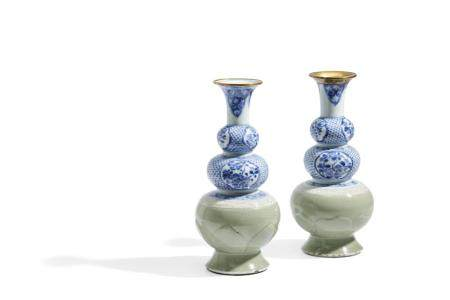 A CLOSE PAIR OF CELADON, BLUE AND WHITE TRIPLE GOURDE VASES,