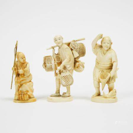 A Group of Three Ivory Okimono of Fishermen and a Merchant, Meiji Period, tallest height 5 in — 12.6