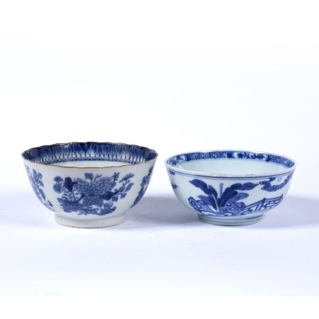 Two blue and white bowls Chinese, 19th Century the first decorated to the exterior depicting a