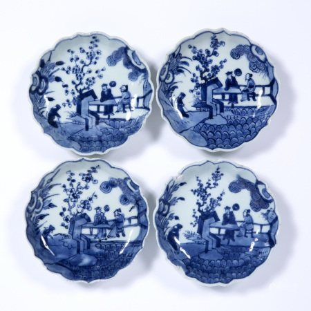 Four blue and white scallop edge dishes Chinese, 18th/19th Century decorated to the centre with