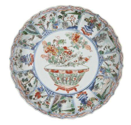 A Chinese porcelain moulded dish, Kangxi period, painted in famille verte enamels with a