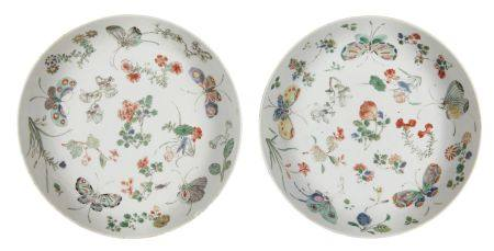 A pair of Chinese porcelain dishes, Kangxi period, painted in famille verte enamels with butterflies