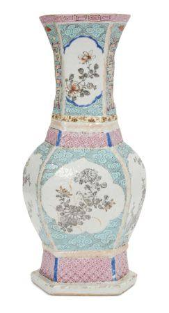 A Chinese porcelain hexagonal vase, Qianlong period, painted in famille rose enamels with panels