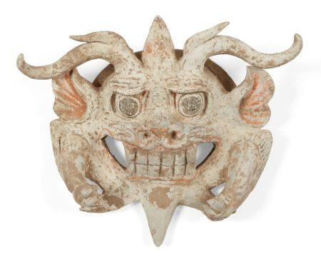 A Chinese terracotta mask with the face of a threatening beast, Tang dynasty, the horned beast