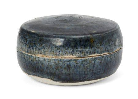 A Chinese blue-glazed pottery cosmetic box, Tang dynasty, of circular form, covered in a slightly
