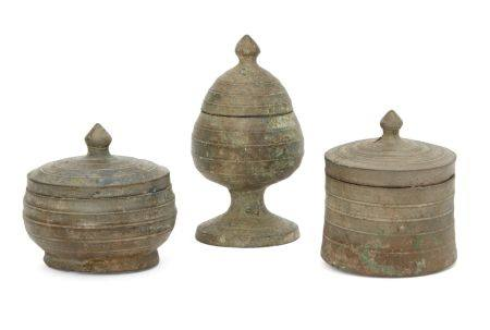 Three Chinese bronze miniature votive covered vessels, Late Six dynasties - Early Tang dynasty,