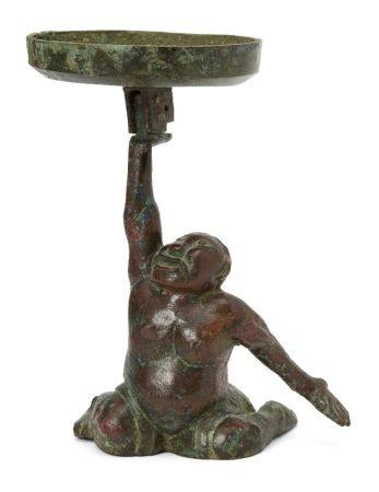 A Chinese bronze figural candleholder, Western Han dynasty, cast as a kneeling 'entertainer' holding