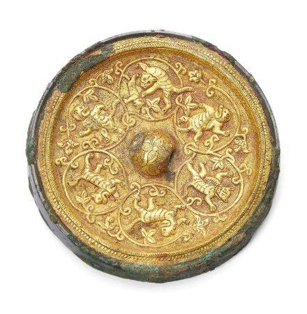 A rare Chinese bronze gold inlaid circular mirror, Tang dynasty, inlaid with a gold sheet finely
