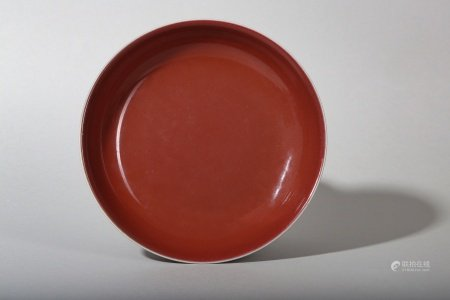 A CHINESE COPPER RED-GLAZED DISH.