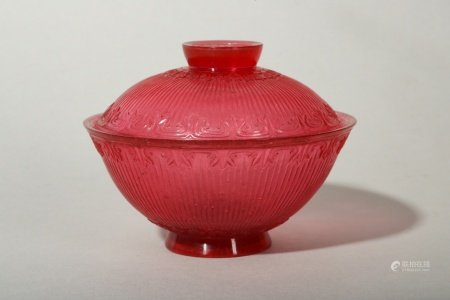 A CHINESE PEKING GLASS RUBY RED TEA BOWL AND COVER.