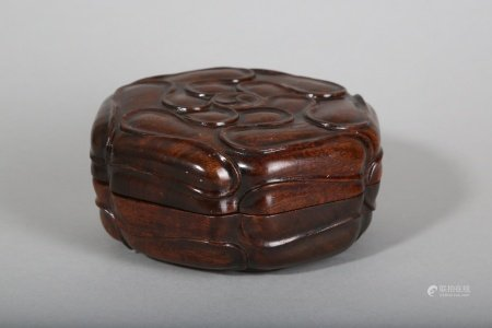 A CHINESE ROSEWOOD HEXAGONAL BOX AND COVER.
