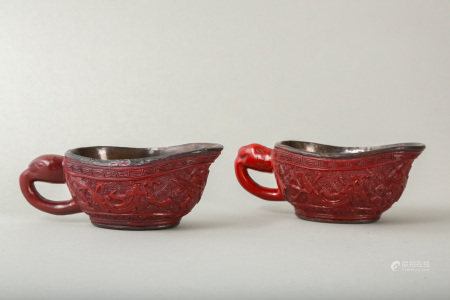 A PAIR OF CHINESE CINNABAR LACQUER POURING VESSELS, YI