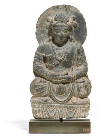 Very rare and fine sitting light grey schist Bodhisattva