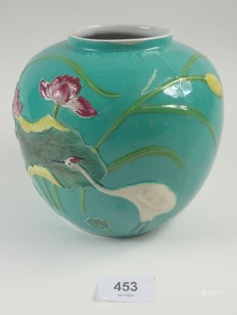 A Chinese turquoise ginger jar decorated lilies, no lid in the style of Wang Bing Rong, 19cm tall