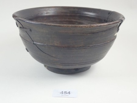 An early wooden Chinese bowl, repaired extensivley, 21 cm diameter