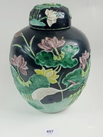 A 19th century Chinese Wang Bing Rong Famille Noir ginger jar with raised stork, flowers decoration,