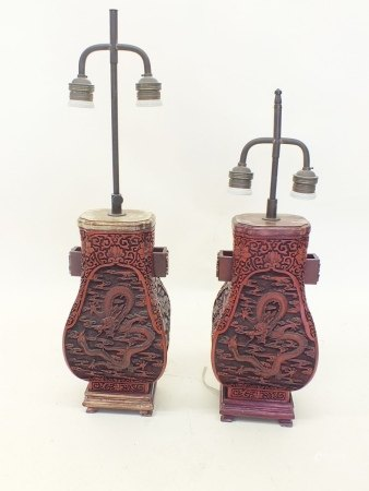 A pair of Chinese red lacquer table lamps, 34cm tall
