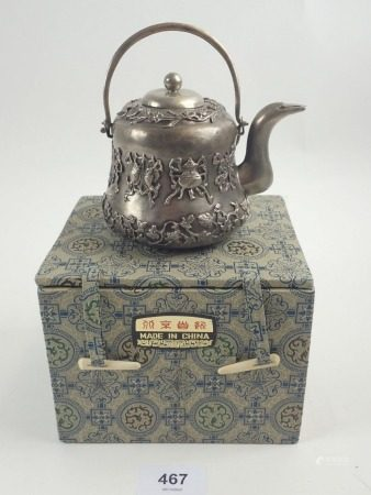 A Chinese white metal small teapot with applied decoration, boxed