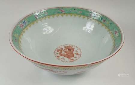 A Chinese porcelain bowl painted dragons and clouds with hairline crack, 28 cm diameter