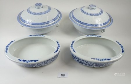 A pair of Chinese blue and white tureens, chipped to lids and a pair of similar oval serving dishes