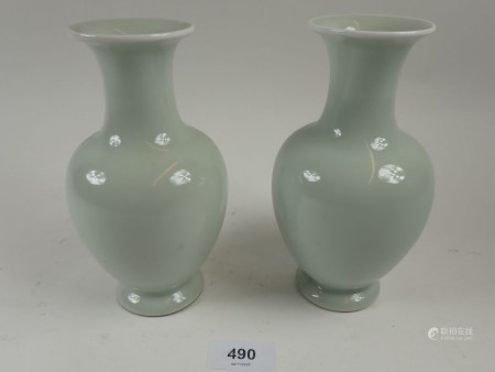 A pair of Chinese celadon baluster vases 16cm, on stands