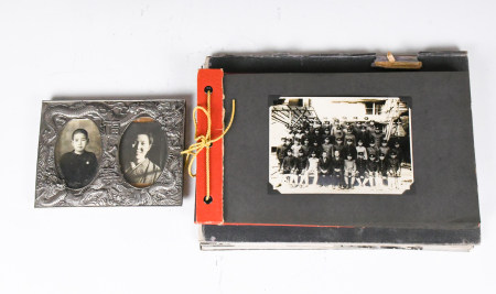 A Group of Old Photo Albums and Photo Frame