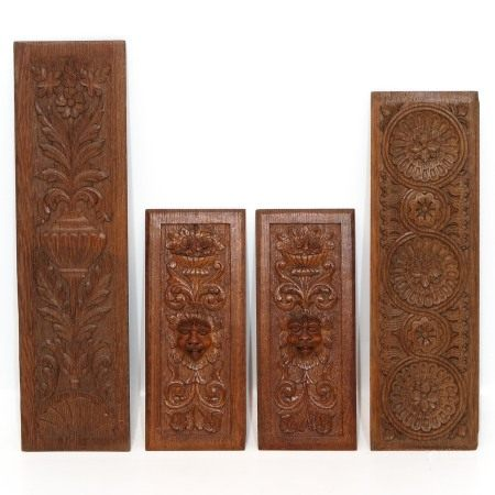 A Collection of 4 Carved Oak Wood Panels